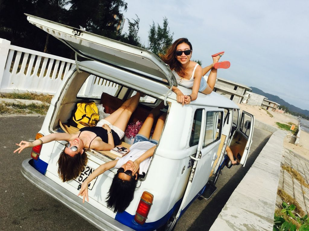 Girls on a van traveling